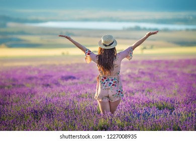 Young magic adorable woman in lavender field on summer day dancing and enjoy life time with woman girl power.