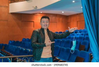 young magician doing magic in a theater. levitating a mask