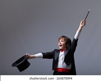 Young magician performing a trick - with lots of copy space