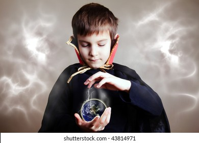 Young magician trying to save the Earth with his magic (focus on the hands/earth)