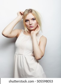 young magnificent woman in white dress.