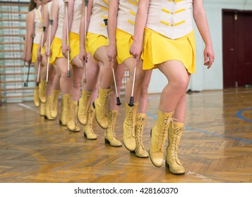 young majorette girls practicing in gym hall
