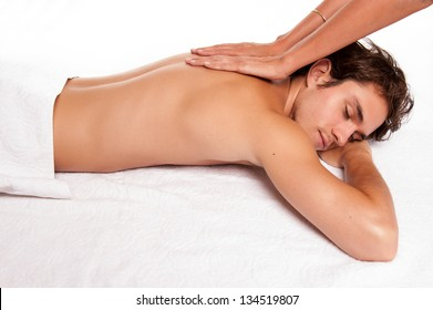 young male adult receiving a massage. studio shot.