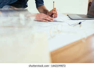 Young male architect at his workspace