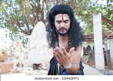 A young male artist as Ravana calls out Lord Rama during the Lord of lanka post photoshoot on December 23rd 2018 at Sai Baba temple in Bengaluru,India