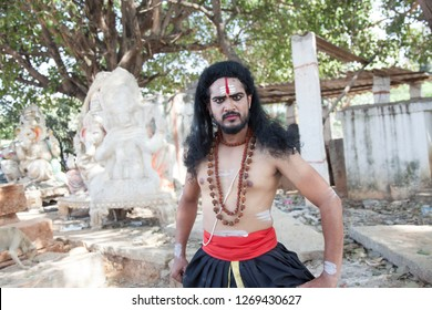 A young male artist as Ravana looks at disdain during the Lord of lanka post photoshoot on December 23rd 2018 at Sai Baba temple in Bengaluru,India