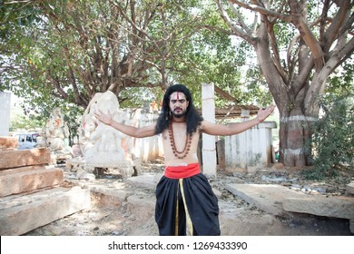A young male artist as Ravana in the middle of the forest ready to do battle during the Lord of lanka post photoshoot on December 23rd 2018 at Sai Baba temple in Bengaluru,India