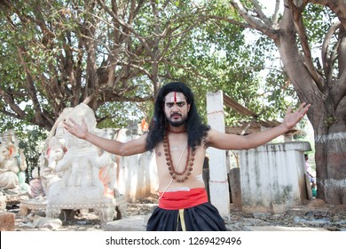 A young male artist as Ravana shows his strength during the Lord of lanka post photoshoot on December 23rd 2018 at Sai Baba temple in Bengaluru,India