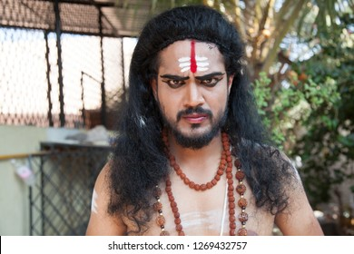 A young male artist as Ravana shows an intense look before battle during the Lord of lanka post photoshoot on December 23rd 2018 at Sai Baba temple in Bengaluru,India