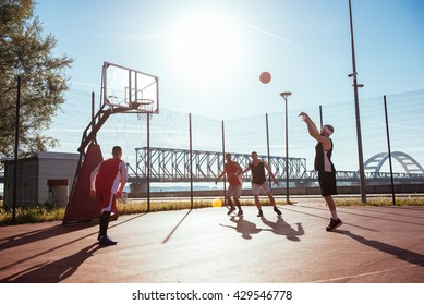 Young male basketball player taking a free throw.