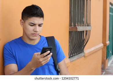 Young male browsing on his cellphone