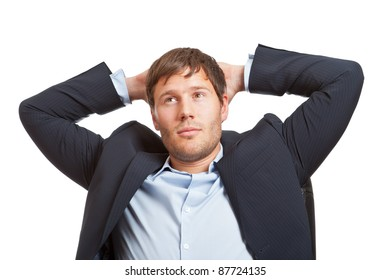 Young male business man thinking or dreaming