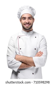 Young male chef isolated on white