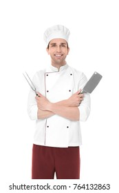 Young male chef with meat fork and knife, isolated on white