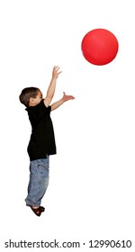 a young male child throwing a large red ball over white background