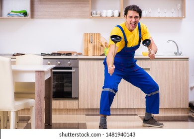 Young male contractor repairing tap at home