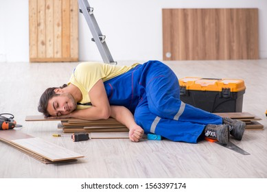 Young male contractor working indoors