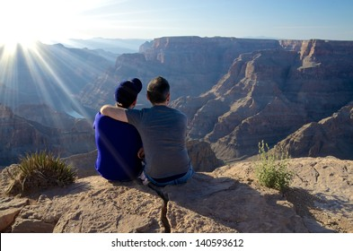 A Young Male Couple Looking Into Grand Canyon