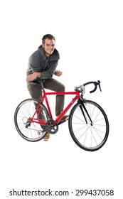 Young Male Cyclist On Bicycle Isolated Over White Background