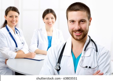 The young male doctor and its colleagues