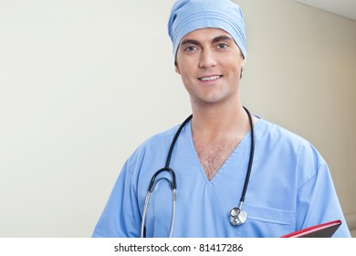 Young male doctor in hospital corridor