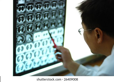 young male doctor looking at CT film