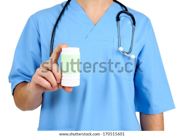 Young male doctor  with pills, isolated on white