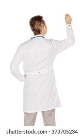 Young  male doctor in white coat writing on blank glass board or virtual screen with marker .People and medicine concept. Image isolated on a white background.