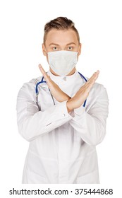 Young  male doctor in white coat and stethoscope making stop sign. People and medicine concept. Image isolated on a white studio background.
