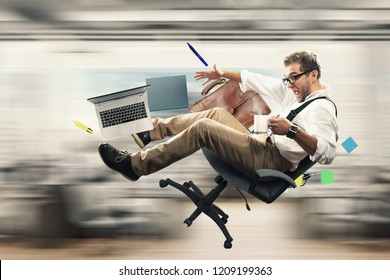 Young male employee falling from the chair