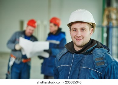 young male engeneer worker at a indoors building site