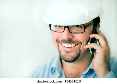 Young male engineer speaking on the phone