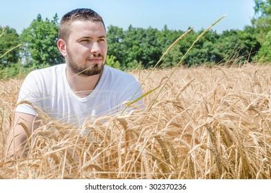 Young male farmer in a field.