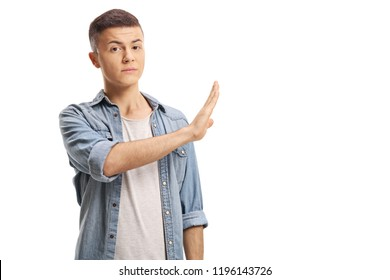 Young male gesturing stop with his hand isolated on white background