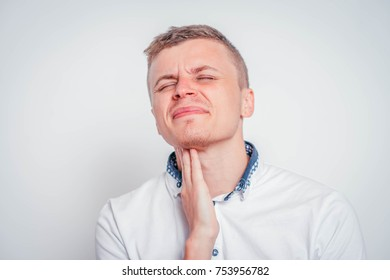 Young male holding the neck. sore throat.