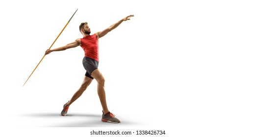Young male javelin thrower throwing a spear on white background. Isolated athlete in sport clothes
