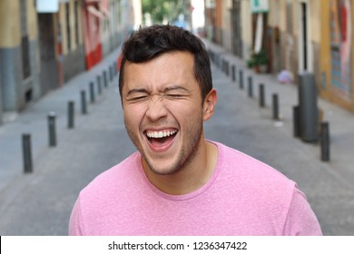 Young male laughing really hard outdoors