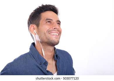 young male listening to earphone, smiling, isolated on white background