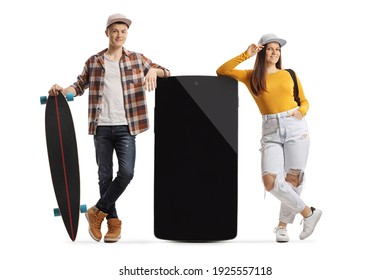Young male with a longboard and female leaning on a big mobile phone isolated on white background