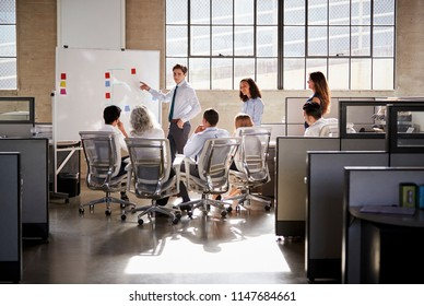 Young male manager using whiteboard in a business meeting