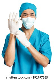 a young  male medical student (nurse, intern, doctor) in rubber gloves
