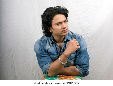 young male model in blue shirt side pose