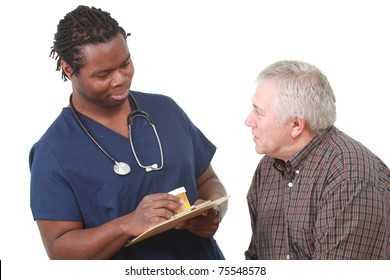 Young male nurse talks about medication with an older patient