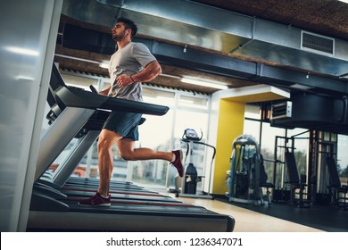 Young male on a treadmill at the gym