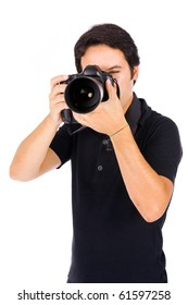 Young male photographer at studio, isolated on white