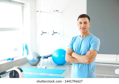 Young male physiotherapist in rehabilitation center
