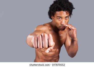 young male punching screen