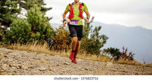 young male runner with camelbak run mountain ultra marathon