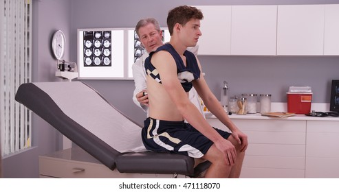 Young male sports athlete having a doctor checkup.