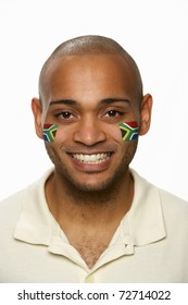 Young Male Sports Fan With South African Flag Painted On Face